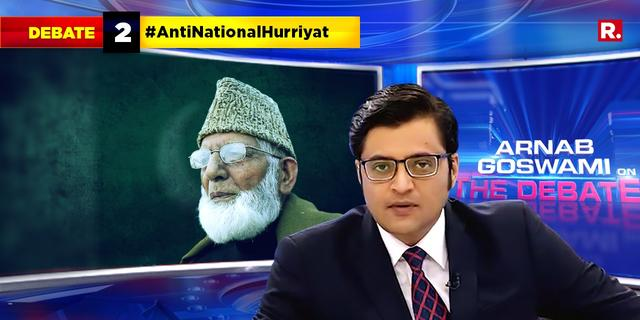 Geelani seen posing with a terrorist, is he using Kashmiri youth as 'pawns'?
