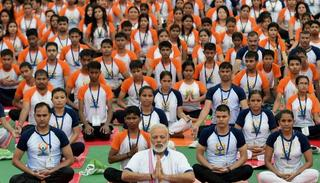 PM Modi practices yoga with the people of Lucknow Credit: PTI