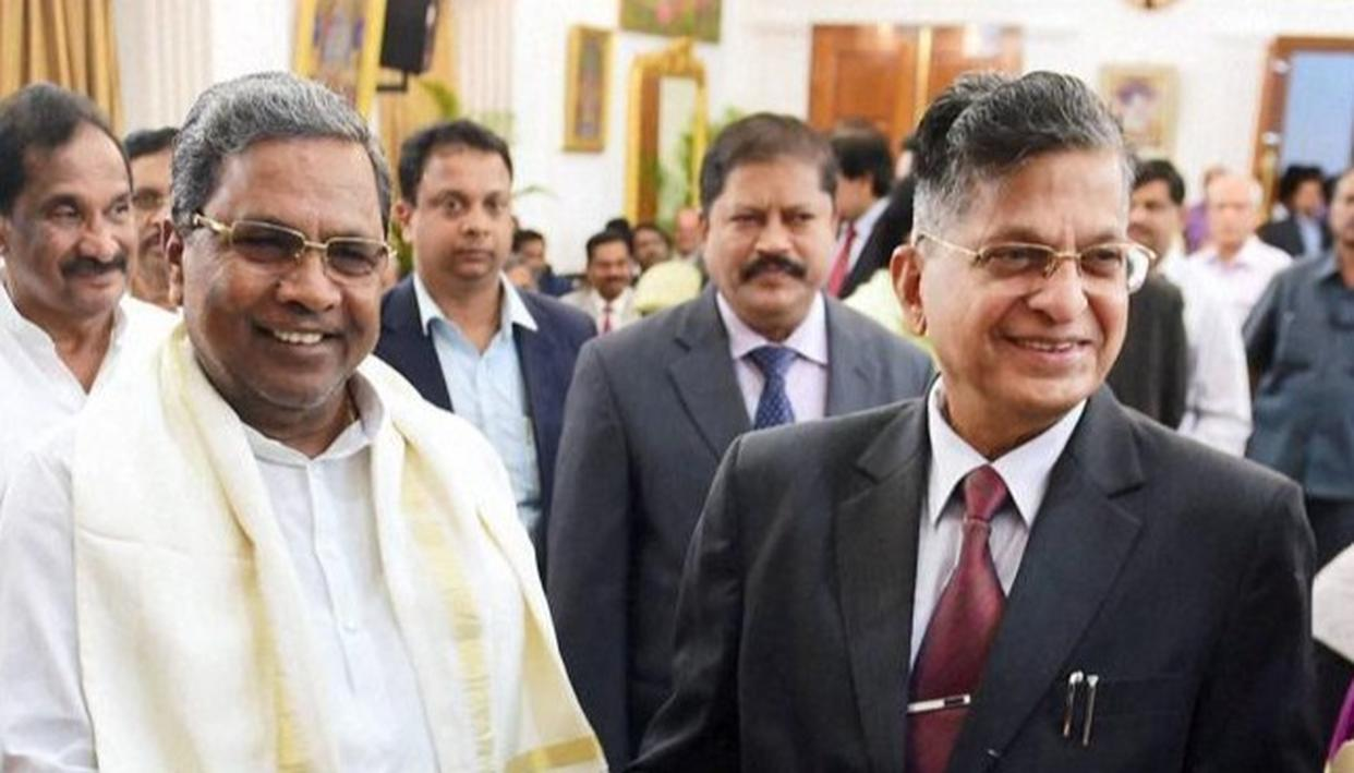 Justice Vishwanath Shetty and Karnataka chief minister Siddaramaiah at the latter's swearing in ceremony (PTI Image)